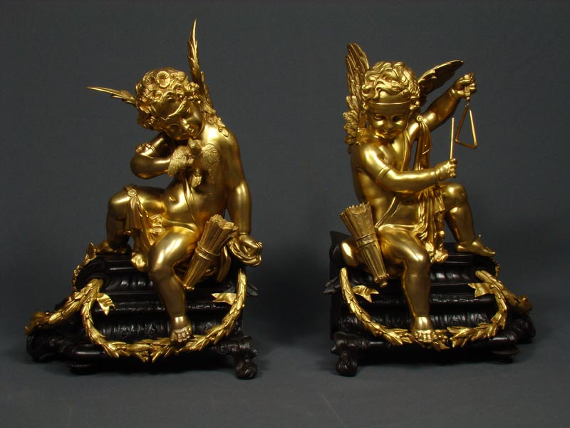 A pair of French Louis XV style gilt and patinated bronze Chenets Cira 1880