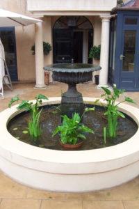 Champagne urn Fountain on a plinth