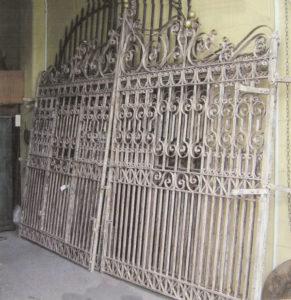 Wrought iron gates with pedestrian gate incorporated
