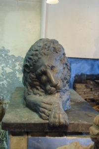 Sleeping lion garden ornament